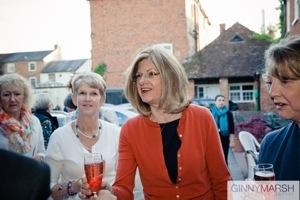 woman in red - Beverley Edmondson millinery