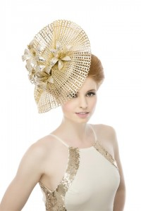 Metallic gold perforated, hand shaped sweep embellished with gold leather lilies upon a beret style base. Photographed by Ginny Marsh Photography.
