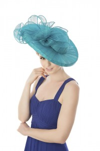 Striking turquoise waved brim layered Sinamay hat with rolled Sinamay trimmings. Photographed by Ginny Marsh Photography.
